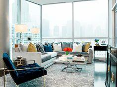 Glamorous #Chicago living room with trellis #rug, blue velvet chair and custom sectional #sofa