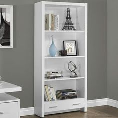 Features:  -Contemporary styling.  -Three adjustable shelves.  -One large storage drawer.  Product Type: -Standard.  Style: -Contemporary.  Finish: -White.  Shelving Included: -Yes.  Orientation: -Tal