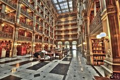 The George Peabody Library in Baltimore, MD is currently part of Johns Hopkins University, though it has changed hands a number of times since its 1857 founding, from the Peabody Institute to the City of Baltimore to the University. The stack room of the library features five tiers of impressive cast-iron balconies.