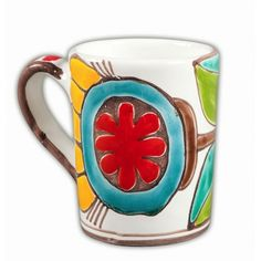 Enjoy a warm cup of coffee or tea in this festive flower mug. From the famous De Simone family of Sicilain ceramic artists, this piece was handmade and hand painted in Palermo, Sicily, Italy. Actual colors may vary.