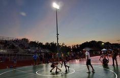 Friday night under the lights wrestling on the football field at G. Ray Bodley High School in Fulton, Friday July 10, 2015.