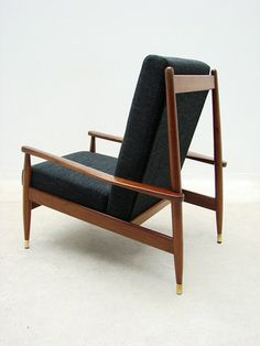 John Duffecy; Blackwood and Brass Lounge Chair, 1960s.