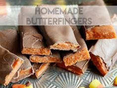 Candy corn and creamy peanut butter melted together and coated in chocolate to create a chewy, delicious copycat Butterfinger candy bar.