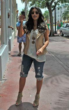 Where can I find Kim Kardashian's tan vest and tan fringe shoes? Vest – Ever Guna Lamb Moto Vest in Chamois  Shoes – Christian Louboutin Deva Suede Tie-Back Boots Sable