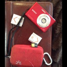 Sony cybershot digital camera Relist due to purchase/cancel . Sony cybershot 14.1 megapixel camera. Comes with three batteries, memory card,  battery charger.. Also free padded bag, keeps camera safe and secure, it's doesn't look that great but is functional. Sony Shoes