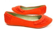 The Natassa    These mango orange flats feature a lovely woven fabric upper and adorable ruffle accents. These flats are super stylish and comfortable for rocking all day.