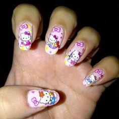Baby pink nail polish with Hello Kitty stickers nail design