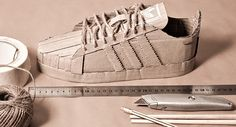 To promote its 2014 lineup of Adidas sneakers, apparel store Chimp had artist Chris Anderson make replicas of the upcoming stock using recycled cardboard.