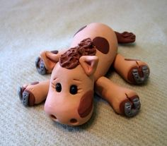 """This cute little horse is ready to rest after a long day of fun. He is approximately 1 1/2"""" high, 3"""" wide and 4"""" long from the tip of his nose to the end of his tail."""