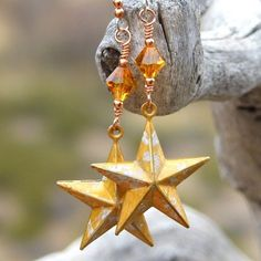 A perfect gift for anyone who loves artisan celestial jewelry, the STARS IN YOUR EYES handmade dangle earrings are so much fun. With their rustic brass Texas stars, hand painted in gold and silver, an