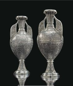 Pair of electroplated Alhambra vases by Tiffany & Co., New York, early 20th c, decorated allover with foliage, arabesques, calligraphy, and animals, one stamped Tiffany & Co., 54 cm high. From christies.com.