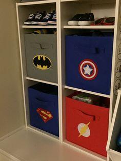 Superhero Nursery - Handmade superhero felt stickers on storage bins in Logan's superhero nursery!