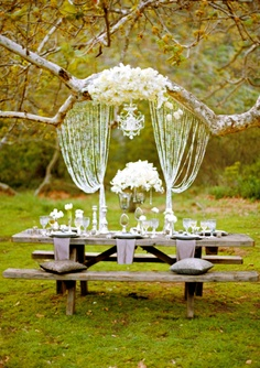 event wedding party tablescape styling hanging chandelier and bead curtains autumn fall by belle magazine
