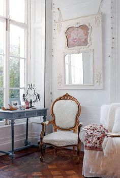I love the large window, parquet floors, and the placement of the mirror in this shabby chic space. We have mirror that compares to this inspiration photo. Check it out http://stylishvintagedecor.com/item_765/NEW-Champagne-Mirror.htm