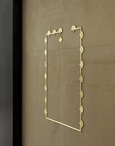 'Walk through Tate Britain' map of the chronological circuit cut in brass where the 'Tate Pro' typeface is used