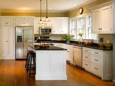 Inspiration for my parents kitchen, but mirrored. I like the concept of 3 double hung windows w/ 4 or 12 lights, the cabinet style, and the wood floors.