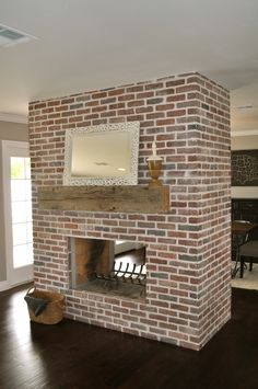 Custom brick work on two-sided fireplace - by Rafterhouse. Brick Fireplace Wall, Fireplace Redo, Double Sided Fireplace, Bedroom Fireplace, Farmhouse Fireplace, Fireplace Remodel, Living Room With Fireplace, Fireplace Design, Fireplace Ideas
