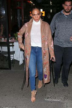 Fashion statement: The Shades Of Blue star opted for a partly see-through white turtleneck...