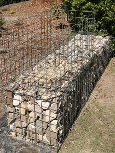 Image from http://gardendrum.com/wp-content/uploads/2012/04/GardenDrum-CStewart-11-gabion-wall-lower-level-packed-upper-level-cage-assembled.jpg.