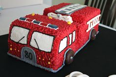 Fire truck cake, jolly ranchers=lights, ladders, windows=fondant