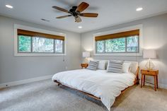 A fan helps with ventilation and cooling. Tagged: Bedroom, Lamps, Bed, Recessed Lighting, Ceiling Lighting, Night Stands, and Carpet Floor. Photo 4 of 6 in 5 Design Tips For a Better Night's Sleep