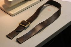 cutting a belt to be used as a bag strap