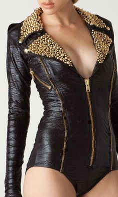 Black Moto romper bodysuit with gold studs on leather collar. $400.00, via Etsy. [[Party Like A Rockstar]]