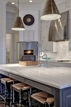 Pizza Oven - Corner wall kitchen with pale gray perimeter cabinets accented with nickel hardware and gray and white marble countertops alongside a white subway tiled backsplash. Dark Grey Kitchen, Grey Kitchen Island, Grey Kitchen Cabinets, Inset Cabinets, Kitchen Sink, Home Decor Kitchen, Kitchen Interior, Home Kitchens, Kitchen Design