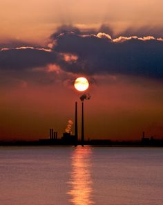 The Poolbeg Generating Station, aka, The Pigeon House, is one of the tallest structures in Ireland and is visible from most of Dublin city. Dublin Bay, Dublin Ireland, Pigeon House, Sunrise Pictures, Sunset Photos, Winter Sunset, Photography Gallery, Stars And Moon, Sun Moon