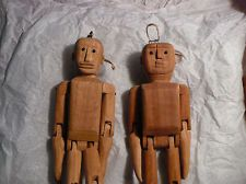 This variation of the jig doll does not have a stick handle in back, rather a string loop on the head that the puppeteer dangles the jig doll over the board with. No doing flips or headstands with these guys!