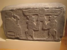 excellent winged sun disc, with...satyr¡? ´Hittite relief