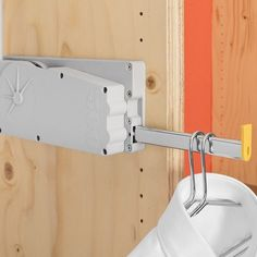 Adjustable to fit spaces from 750mm to 1150mm wide, the Ambos Lift 500 has a 10 kg load capacity and a convenient pull out coat hanger rest (shown here). These wardrobe lifts can be lowered to load or to retrieve the item you want, then raised back up, allowing you to make use of higher spaces that what you can comfortably reach.