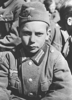 A 13-year-old POW from a Hitler Youth unit captured by the US Army in Martinteselle, March/April 1945.