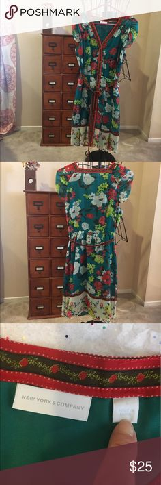 """Floral Button Down Dress SZ Small Floral Button Down Dress SZ Small - Arm pit to arm pit 20"""" - Length 37"""" - Super cute floral patter with a wrap around tie New York & Company Dresses Midi"""