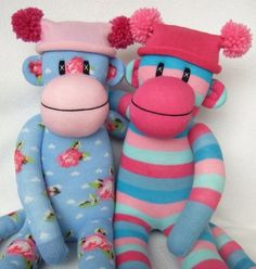 craftdiscoveries:  shabby chic rose sock monkey and pink and blue stripe sock monkey (by sunsetgirl creations)