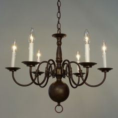 WOULD PREFER CANDLES HAD GLASS AROUND THEM; AND THE BIG BALL HAD A LIGHT POINTING DOWN; Classic Lighting Classic Williamsburgs 6 Light Candle Chandelier