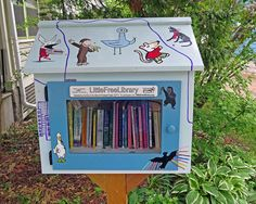 Little Free Libraries 2013.05.25 076 | Flickr - Kerry Hill  decorated with beloved children's book characters (although I only recognize Curious George and Olivia the Pig)