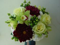 This is similar to my wedding bouquet, minus the dark flowers plus more orchids and freesia.