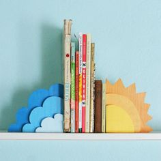 cloud/sun wooden bookends- this is really cute. Only I can't help but think of putting half a sun on either side on top of a cloud bookshelf I saw once.