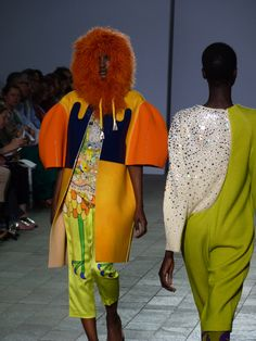 The world sees Manri Kishimoto's design for the very 1st time at the CSM Fashion Show on the 29th of May 2012. The beads are all Svarowsky.