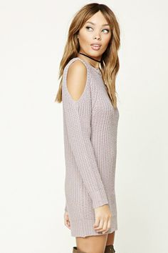 A ribbed knit sweater dress featuring a mini length, an open-shoulder design, a round neckline, and long sleeves.