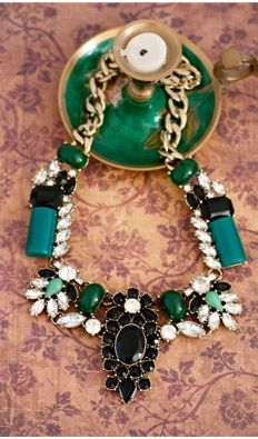 Crystal encrusted statement necklace. Measures at 19.6 inches long. Imported.