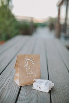 Sweet favor bags. Photography by takenbylightphotography.com/ Event Planning, Design + Stationery by charmedeventsplanning.com Floral Design by poppyspetalworks.com/index2.php#/home/  Read more - http://www.stylemepretty.com/2013/06/06/woodside-wedding-from-charmed-events-group-taken-by-light-photography/