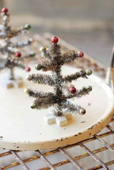 """- Mini Christmas Tree. Perfect for small Christmas vignettes. - 5-1/2"""" tall. - Tinsel, wire, resin. - Imported."""