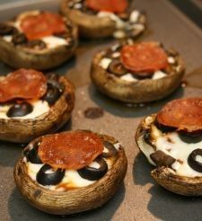 Portabella Pizza Bites    Ingredients:  6 mini Portabella mushrooms (or 2 large Portabella mushroom caps)  1/2 cup marinara sauce (if all you have is a tomato, you can try my Xed Pizza Sauce)  1/2 oz. turkey pepperoni (approx. 6 slices)  2 oz. black olives  3 oz. low-fat Mozzarella cheese  1 egg white       Preheat oven to 400 degrees. Clean mushro
