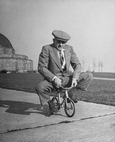 "Chicago bicycle dealer Andy Koslow rides a tiny bike built by a former vaudevillian. ""This helps limber up his left leg,"" LIFE wrote, ""which, as a former motorcycle racer, he broke seven times."""
