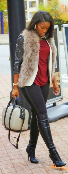 That fur vest piece is hard to do. I've seen them too short, too long, too thick. I think she rocks this one well. ~mzg