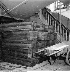 1944 - 1945. Coffins pilled up in the Zuiderkerk. The Zuiderkerk in Amsterdam was temporarily used as an emergency mortuary during the hongerwinter because not all the deaths could be buried immediately. The ground was frozen due to the harsh winter and there was also a shortage of coffins. #amsterdam #worldwar2 #hongerwinter #Zuiderkerk