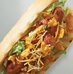 Hot dogs and walking tacos are 2 great options for tailgating, so combine them. Load up a grilled dog with all of your favorite taco fixin's for a Walking Taco Dog. Don't you love that?