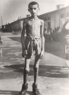 May 1945 Mauthausen Concentration Camp in Austria - A boy after the liberation.
